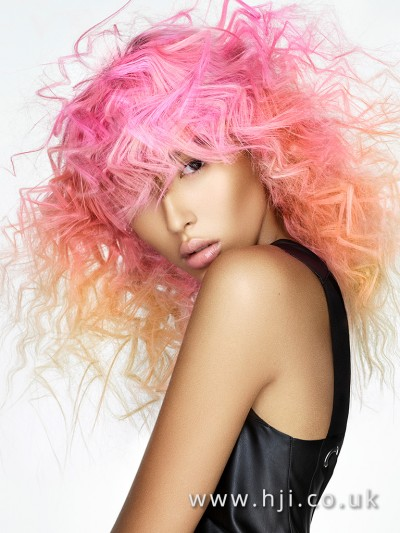 Pink and peach curly balayage hairstyle