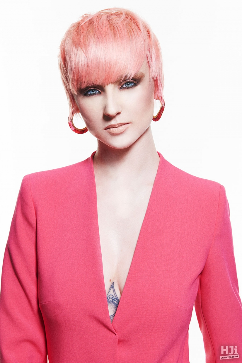 Short pixie crop in light pink with an eyelash skimming fringe