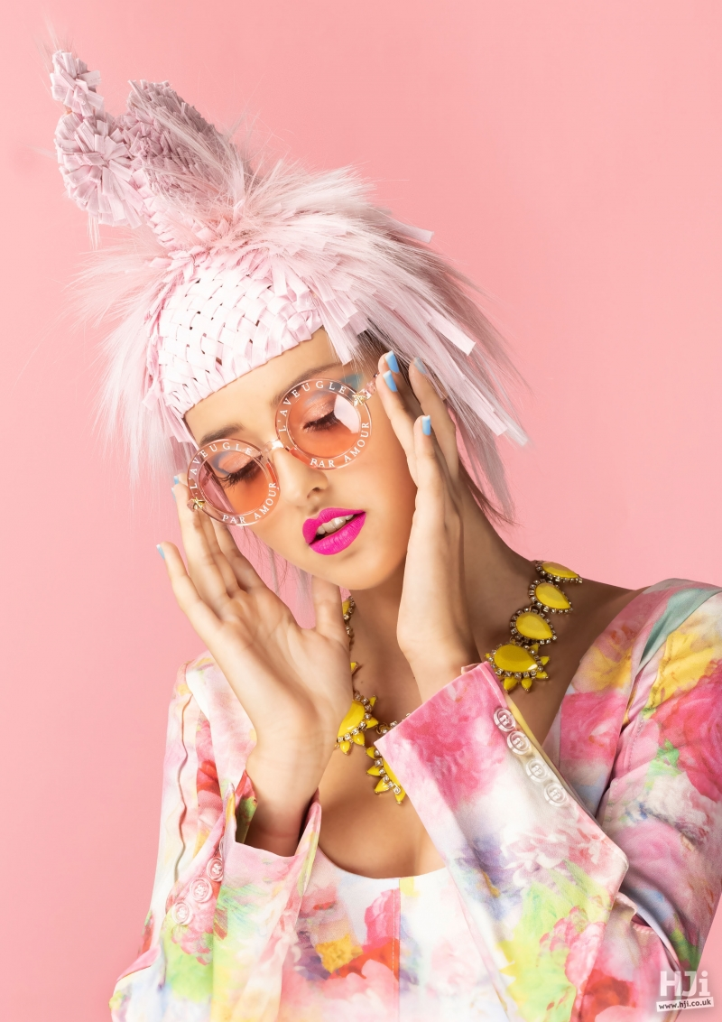 Avant-garde light pink updo with accessories