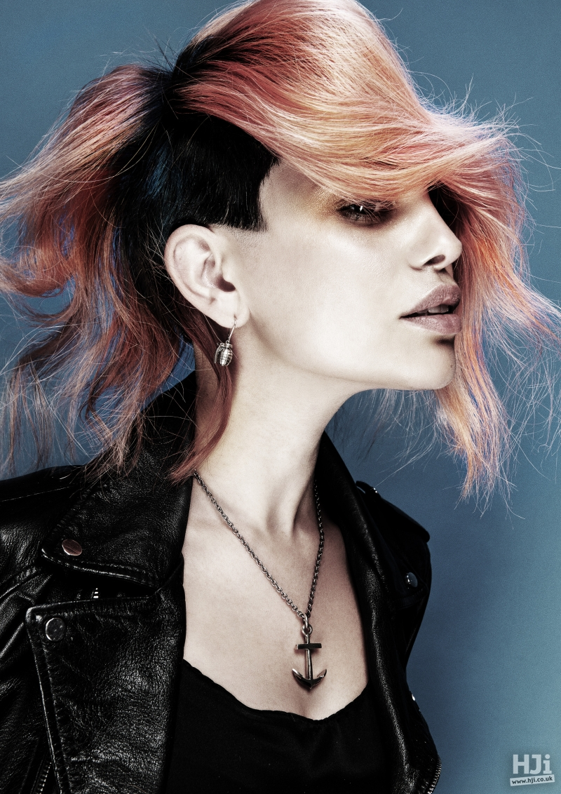 Black undercut with long wavy rose gold side sweeping fringe