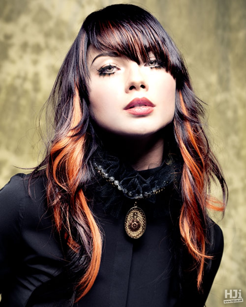 Tousled waves with orange highlights