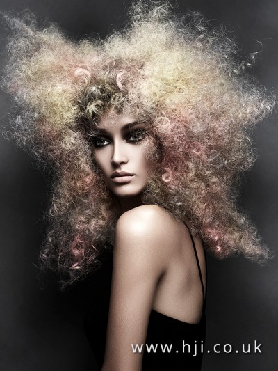 Stunning curls in a fusion of blonde and pink tones