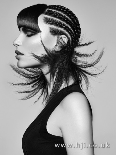 Long braided hairstyle with crimped ends and a sleek fringe