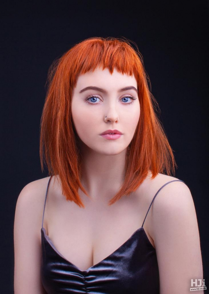 Copper colour with mid-length style and short fringe