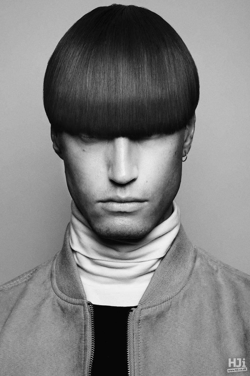 Short sleek men's hairstyle with eyelash skimming fringe