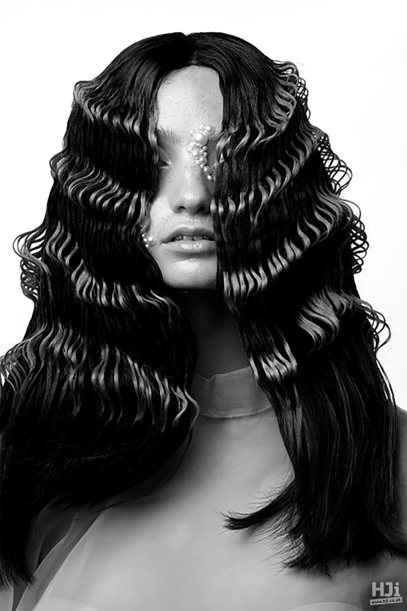 Sharp, prominent waves in sleek black hair