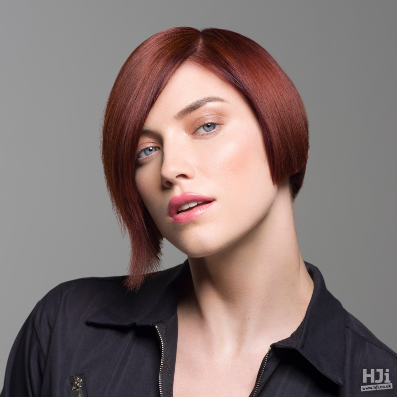 Shiny dark red short bob cut with side parting