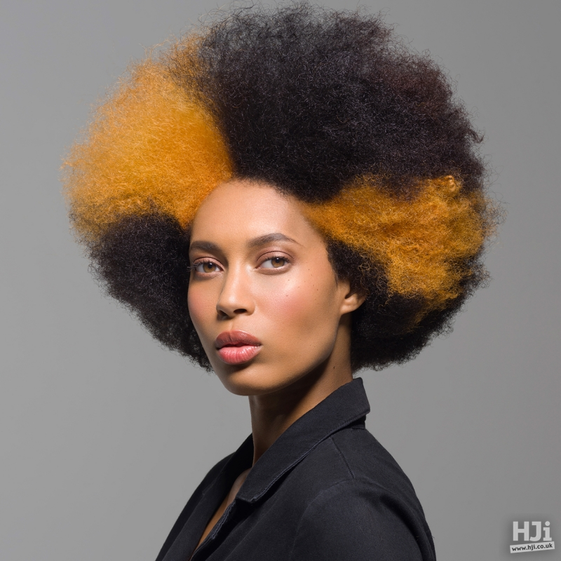 Afro curls with creative irregular orange colouring