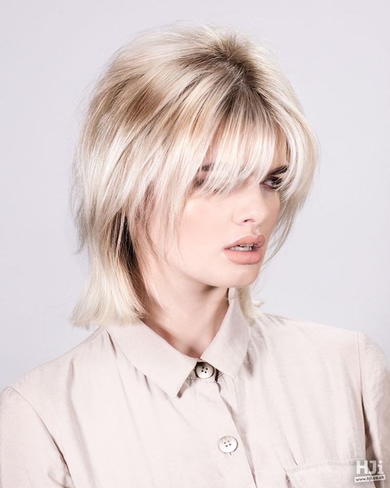 Mid length platinum eyelash skimming fringe hairstyle