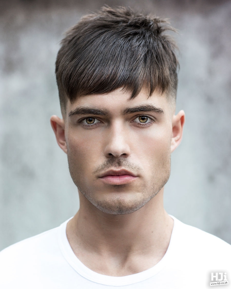 Sleek tapered cut with a side parting fringe
