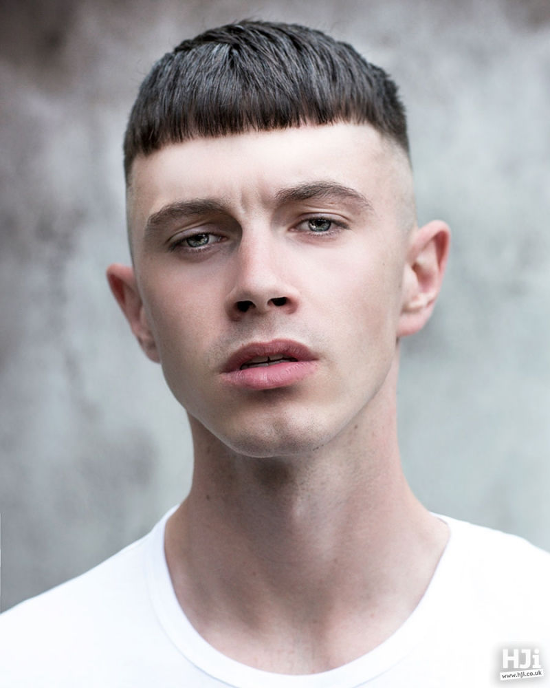 Skin fade brunette hairstyle with a short fringe