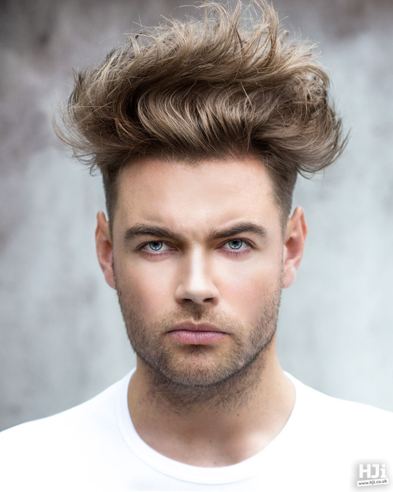A tapered cut short light brown hairstyle