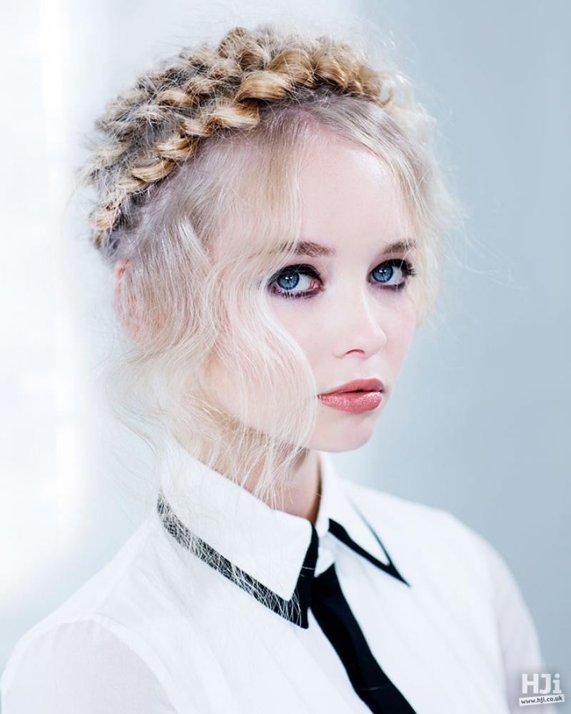Ash blonde hair styled in a crown braid
