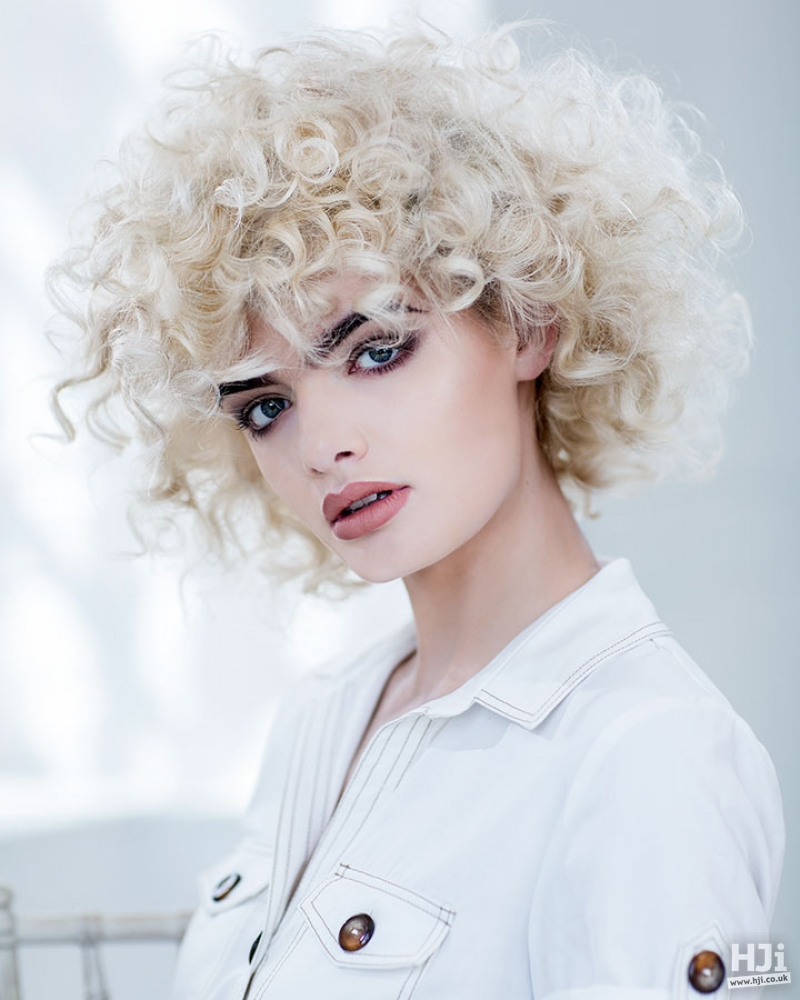 Curly short pearl blonde bob