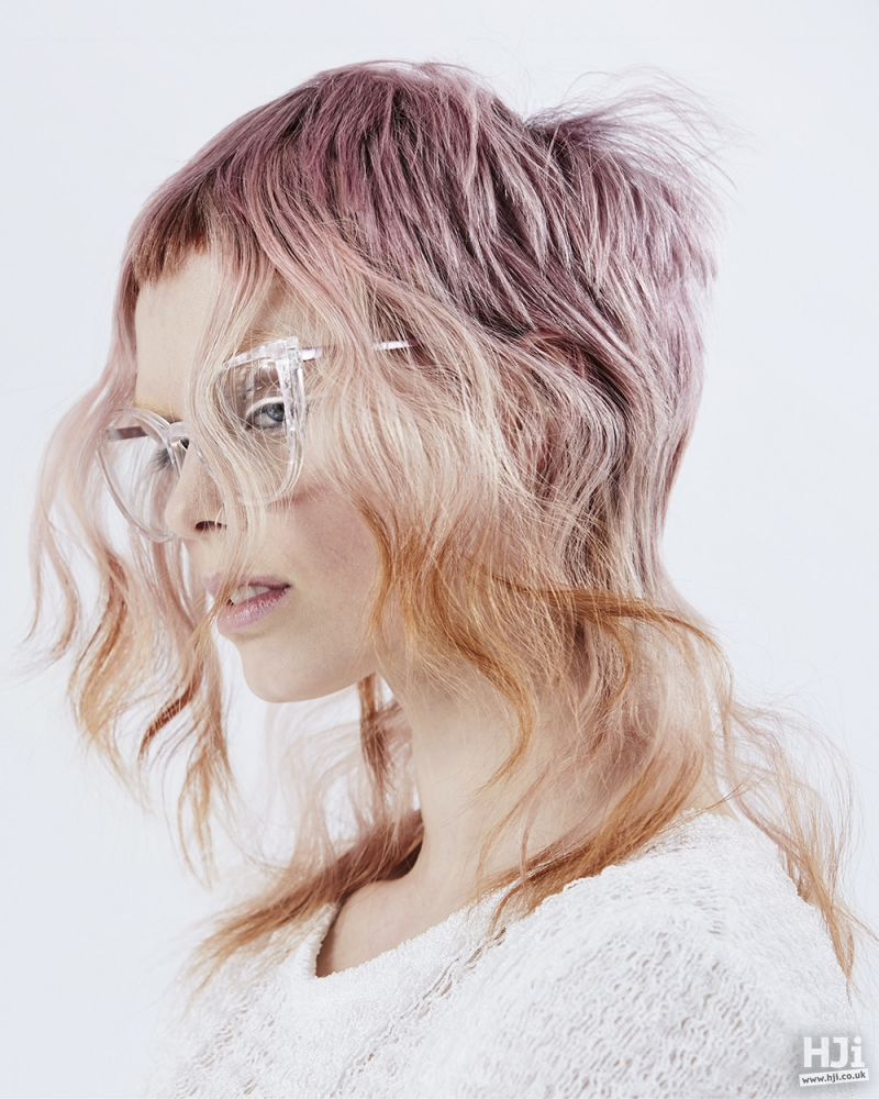 Pink highlights in wavy hair