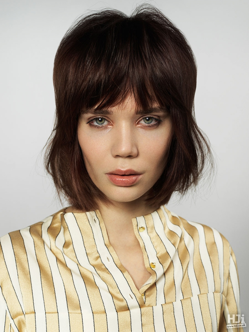 Chocolate brown bob with short fringe and natural texture