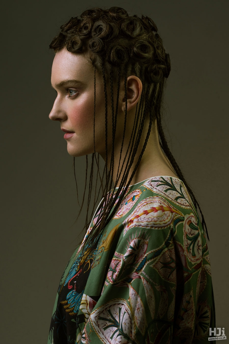 Long brunette hairstyle with multiple small braids, hanging down from multiple small top knots