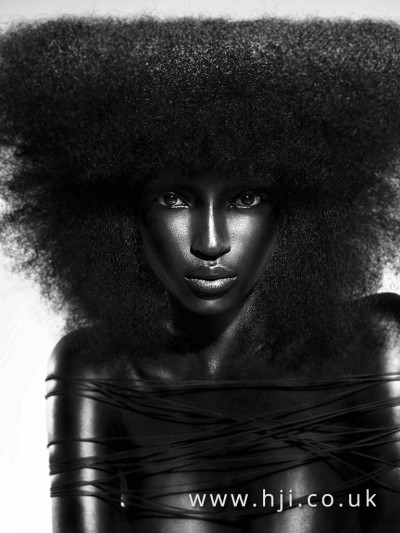 Triangular shaped Afro hairstyle