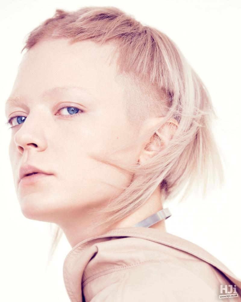 Asymmetric blonde hair.