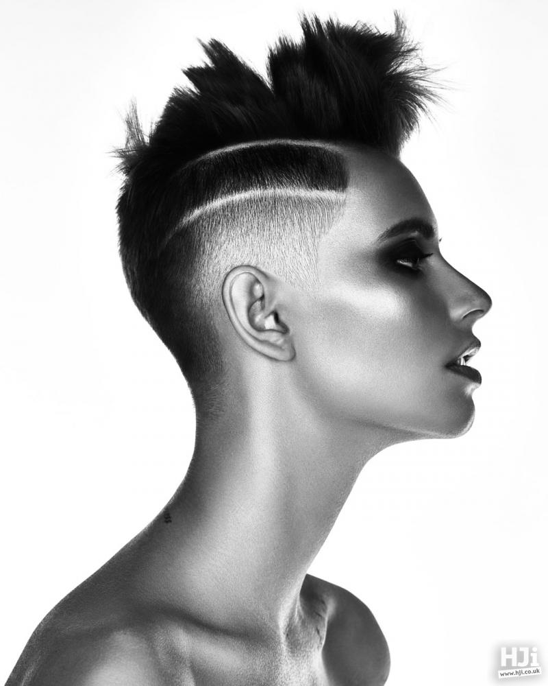 Spiky styling skin fade.