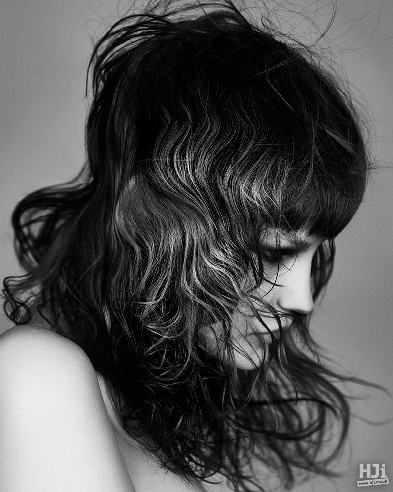 Visor fringe and naturally wavy hair