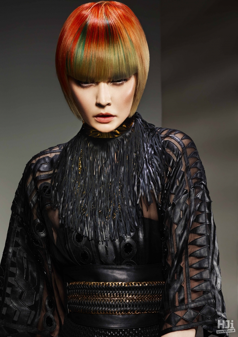 Sleek bob with bright red colour and peekaboo green panel