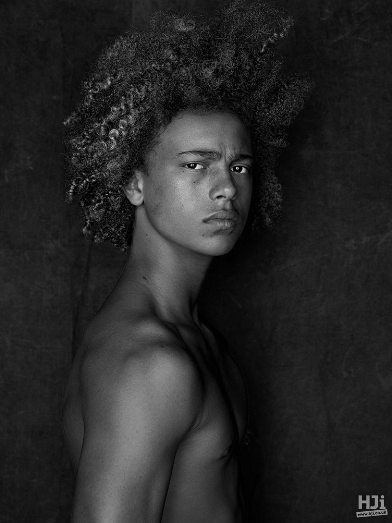 Afro mid length mens hairstyle