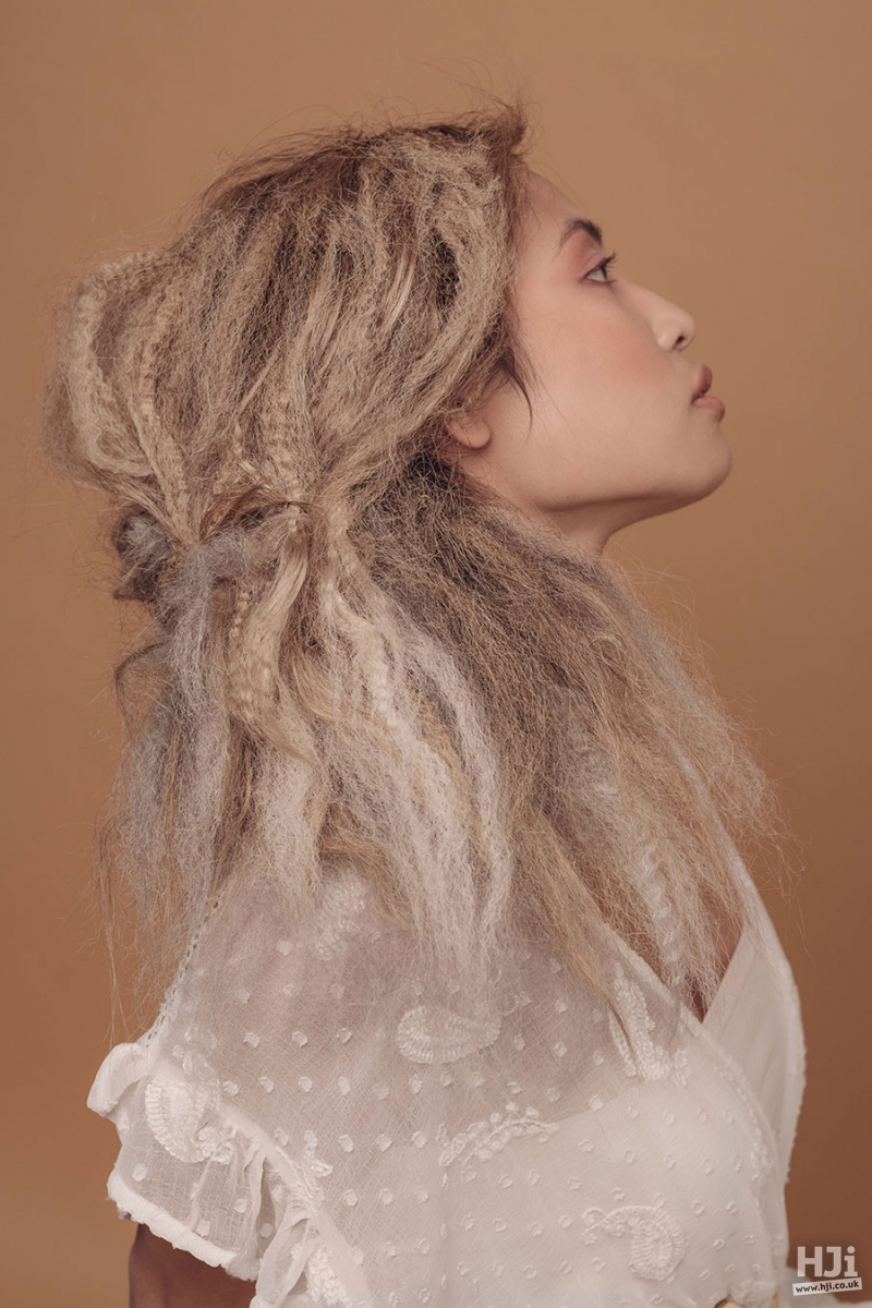 Crimped mid-length hairstyle in ash blond and light brown