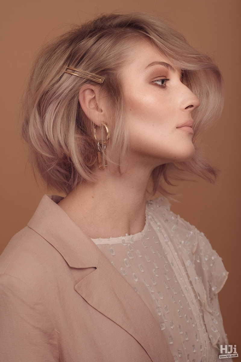Short bob in muted pastel blonde with hair accessories