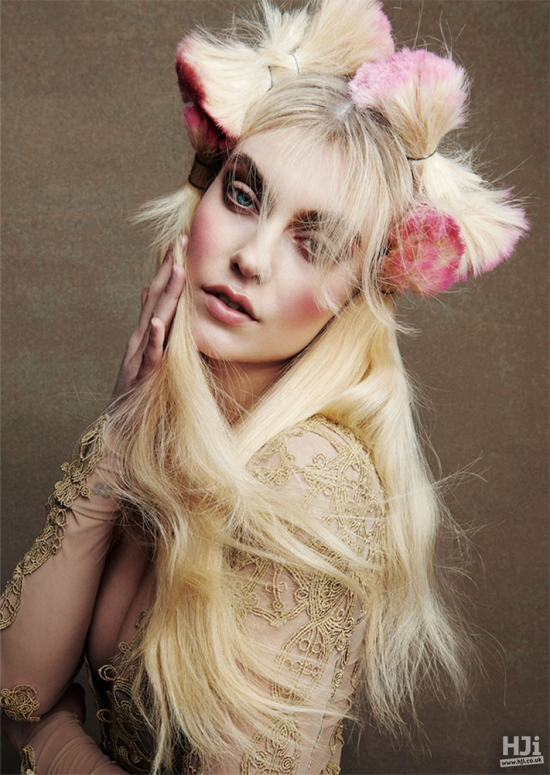 Wavy long blonde hair with avant garde bow styling