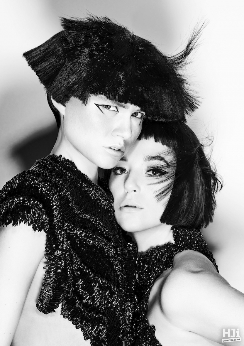 two models with black bobs and fringes