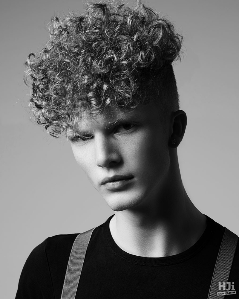 Curly tapered cut men hairstyle
