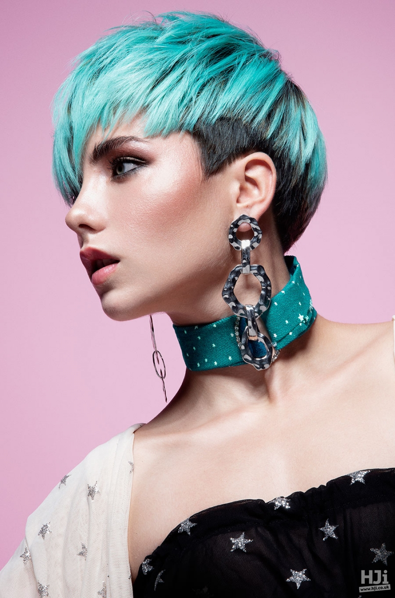 Pixie crop in creative blue colour with peekaboo panels and a sweeping fringe