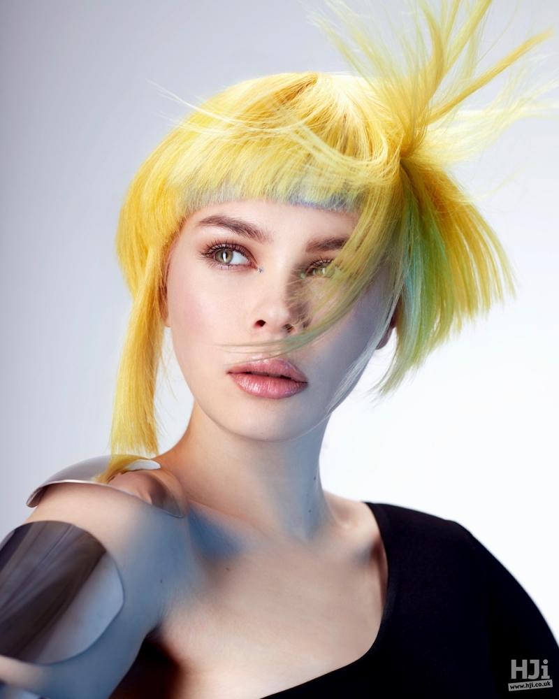 Asymmetric layered hair with visor fringe