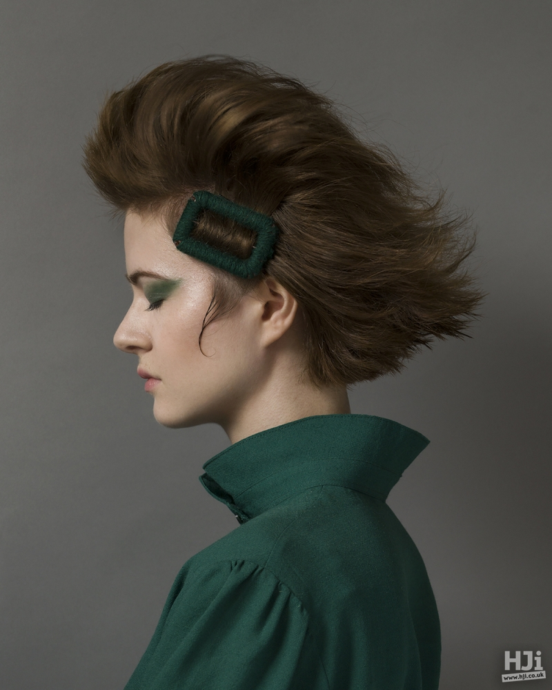 Green accessory on brunette bouffant