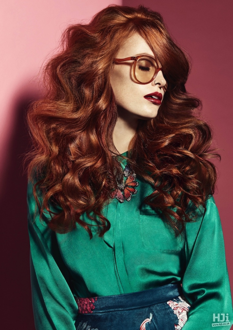 Redhead with long curls and sweeping fringe