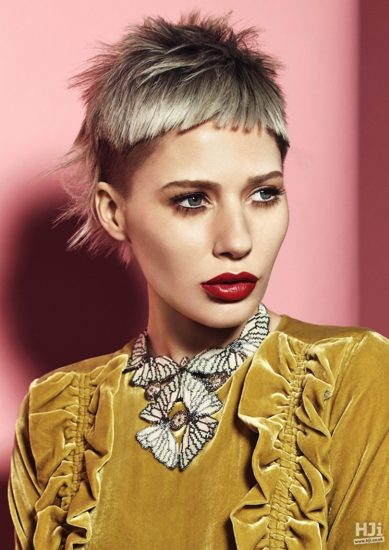 Platinum blonde crop with skin fade and a short fringe