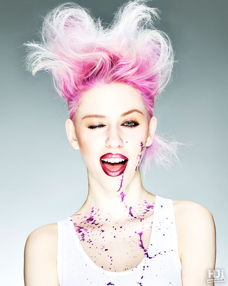 Mid length avant garde hairstyle in a bright pink, light pink and white