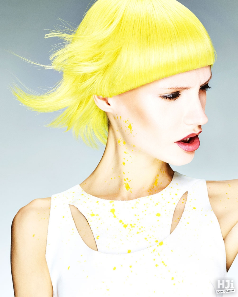 Short avant garde hairstyle in bright yellow with a short fringe