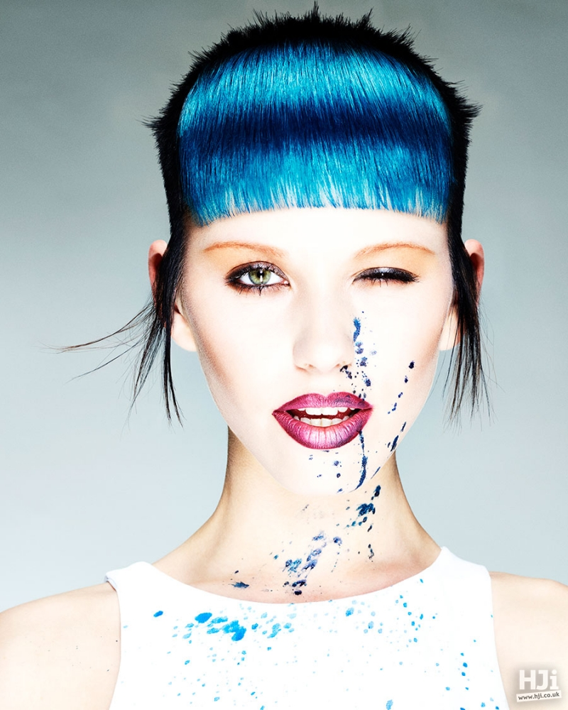 Short sleek hairstyle in black and light blue with a short fringe