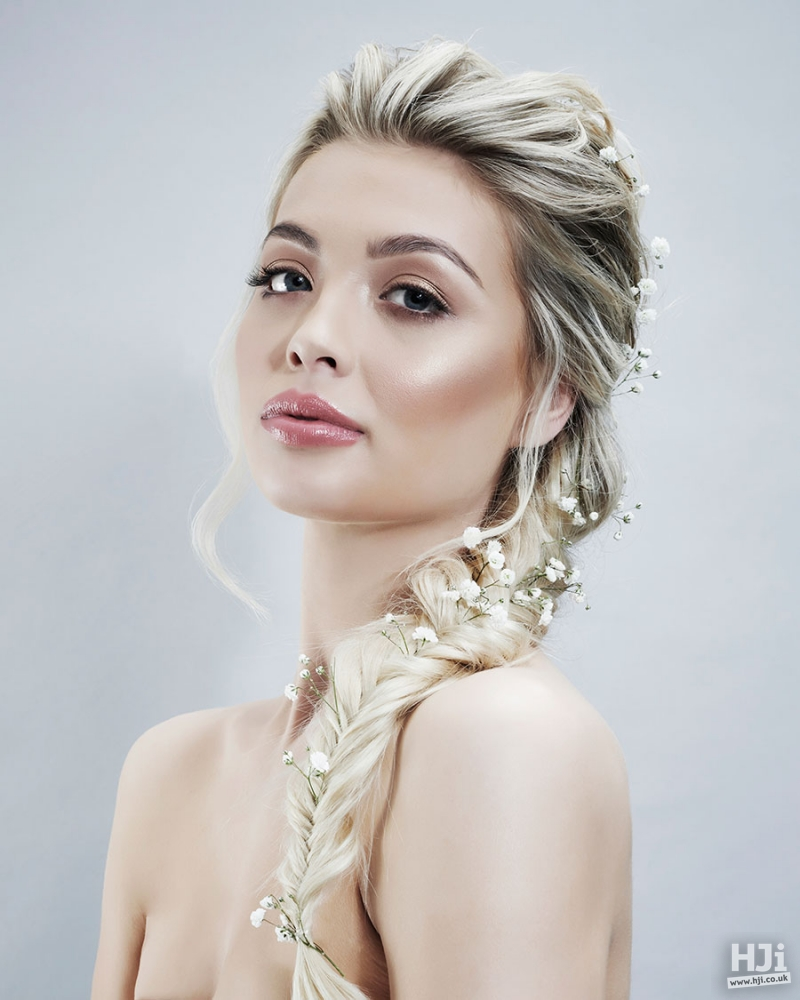 Blonde long braid with flowers