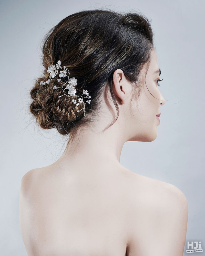Brunette updo bridal hairstyle with flowers