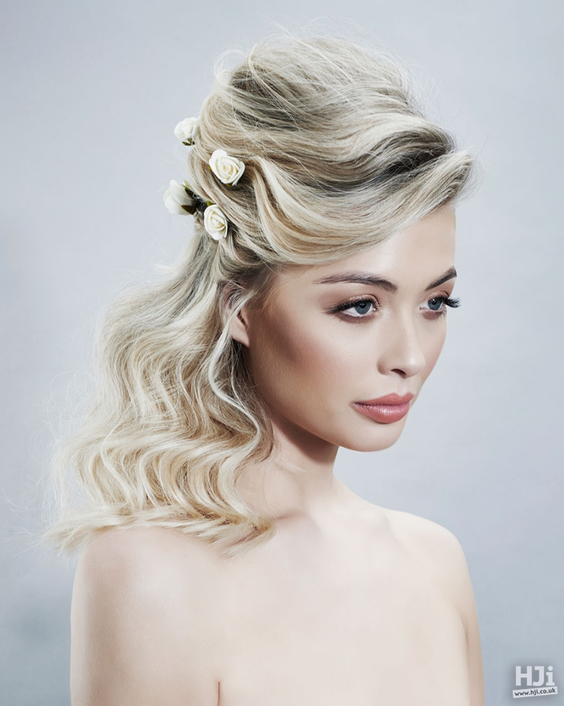 Blonde hair weaving bridal hairstyle with flowers