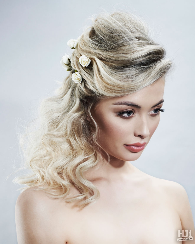Blonde bridal hairstyle with flowers