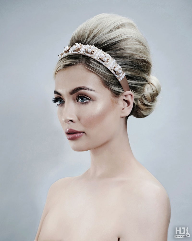 Blonde updo bridal hairstyle with headband and pearls