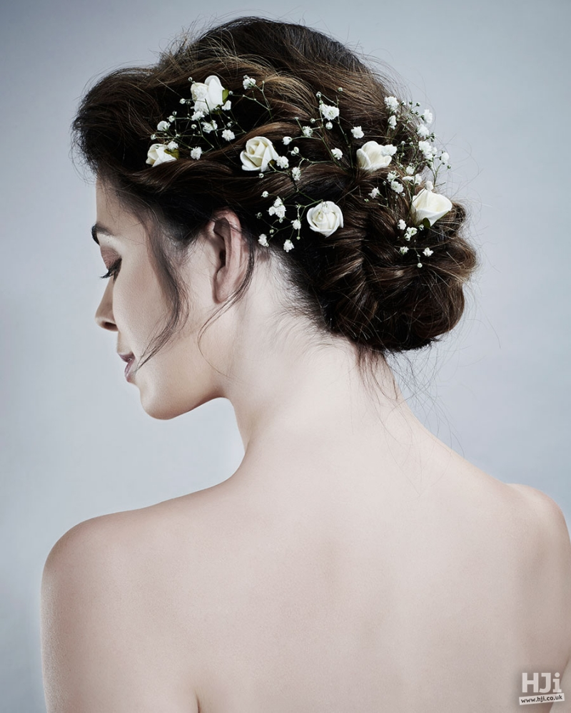 Brunette bridal hairstyle with flowers