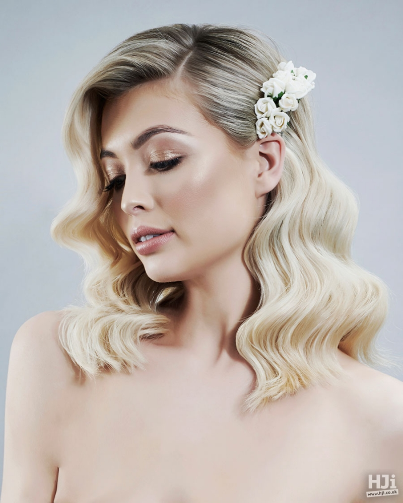 Blonde waves bridal hairstyle with flowers