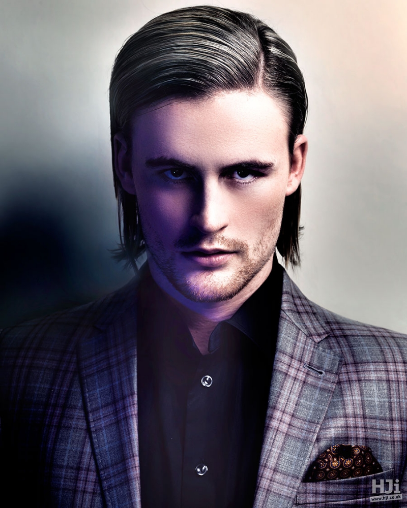 Sleek men's hairstyle with highlights