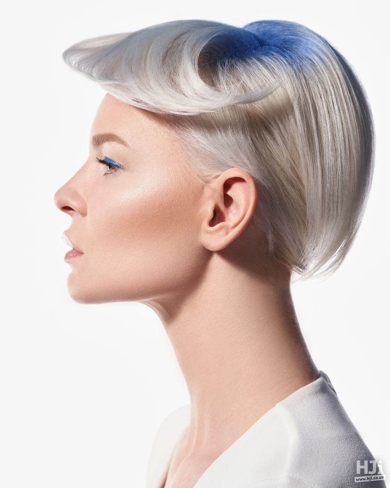 Sweeping platinum blonde fringe with blue shades