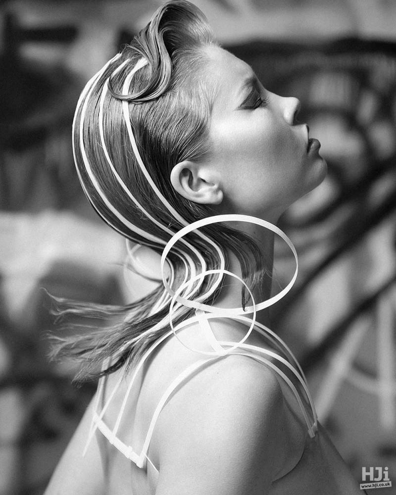 Avant-garde accessories in slick hair